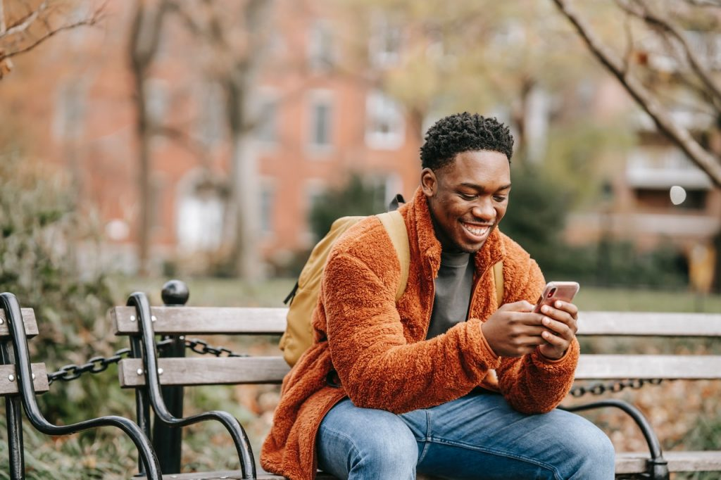 Man smiling when he read an sms